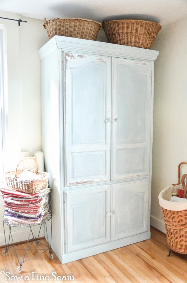 old tv armoire painted with milk paint and repurosed for storage
