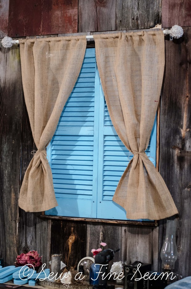 Burlap curtain at an inside window, paired with shutters