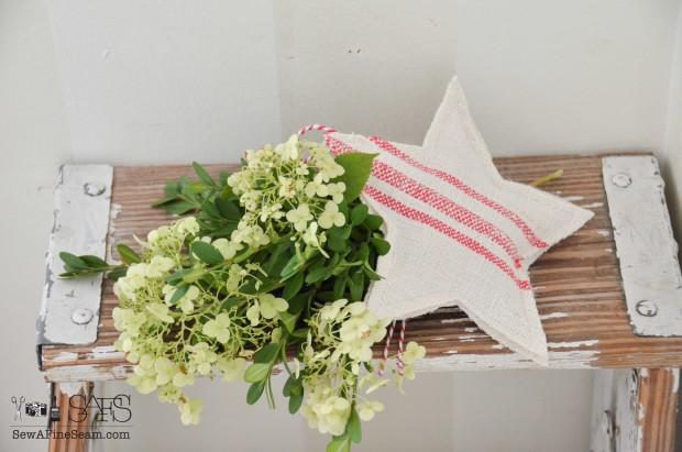 European grain sack made into star christmas ornaments.