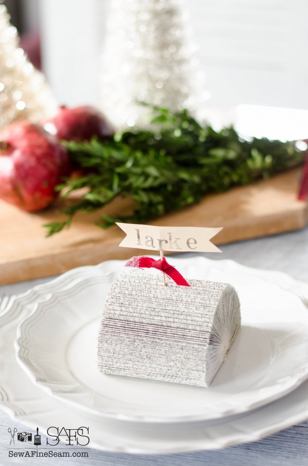 Place card holders made from old books, a toothpick, ribbon, and washi tape