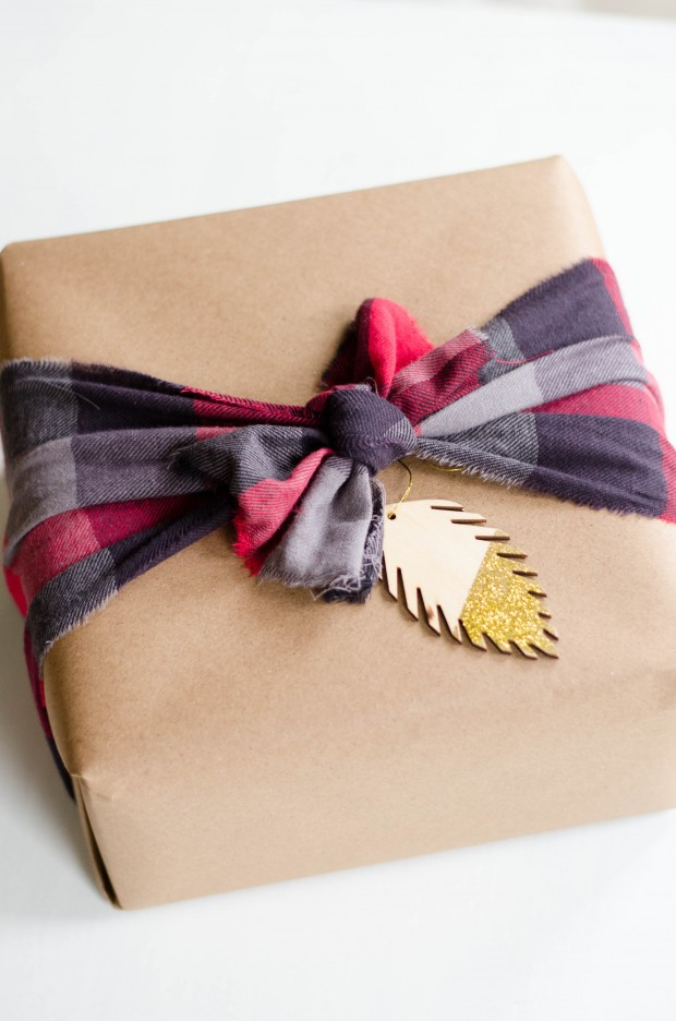 a strip of plaid fabric works in place of a ribbon for a fun christmas package