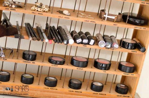 Makeup organized in a Vintage RIT Dye Rack