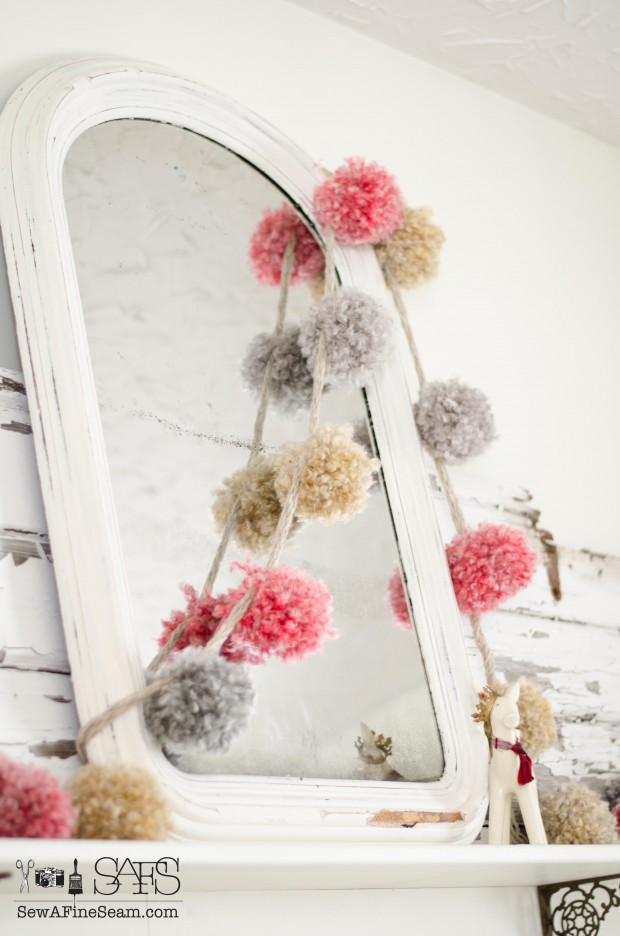 handmade pompom garland over a vintage mirror