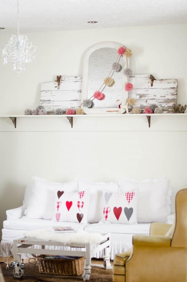 handmade pompom garland and handmade pillows