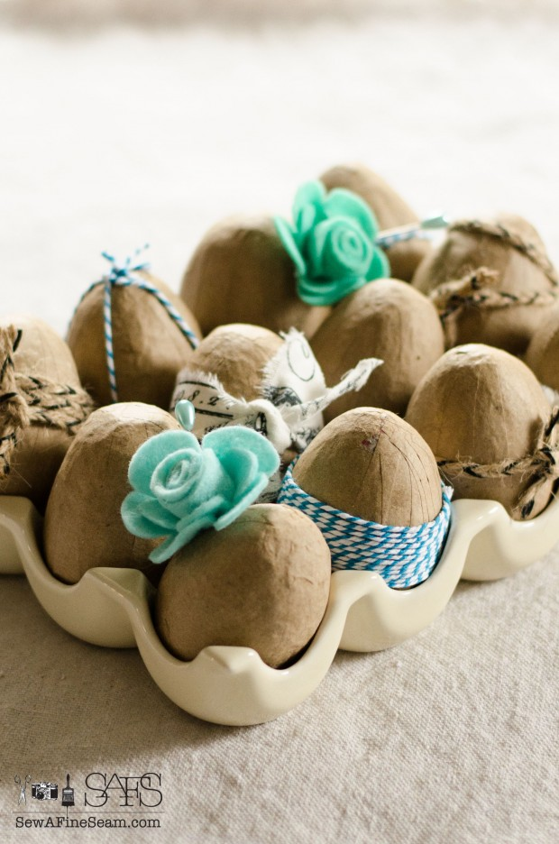 easter egg decor created using faux eggs and ribbons and flowers