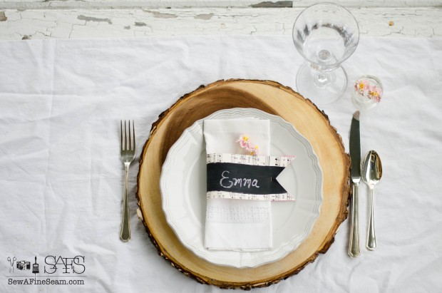 chalkboard paint and sheet music create fun name cards for a Spring table