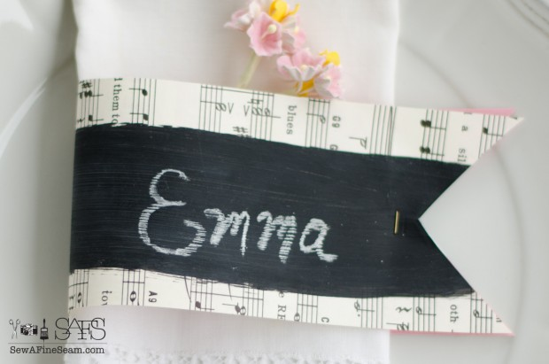 chalkboard paint and sheet music name cards stapled around a napkin