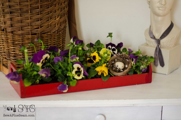spring farmhouse decor toolbox of pansies