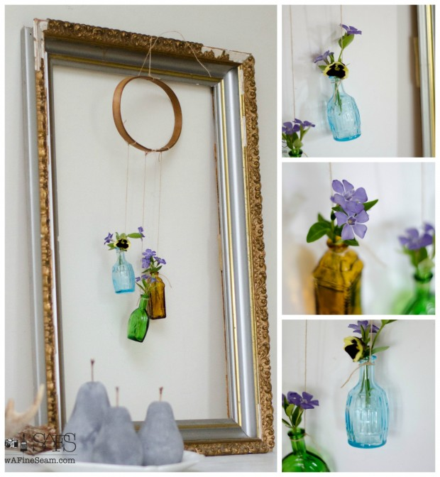 flower vase made from tiny glass bottles and an embroidery hoop