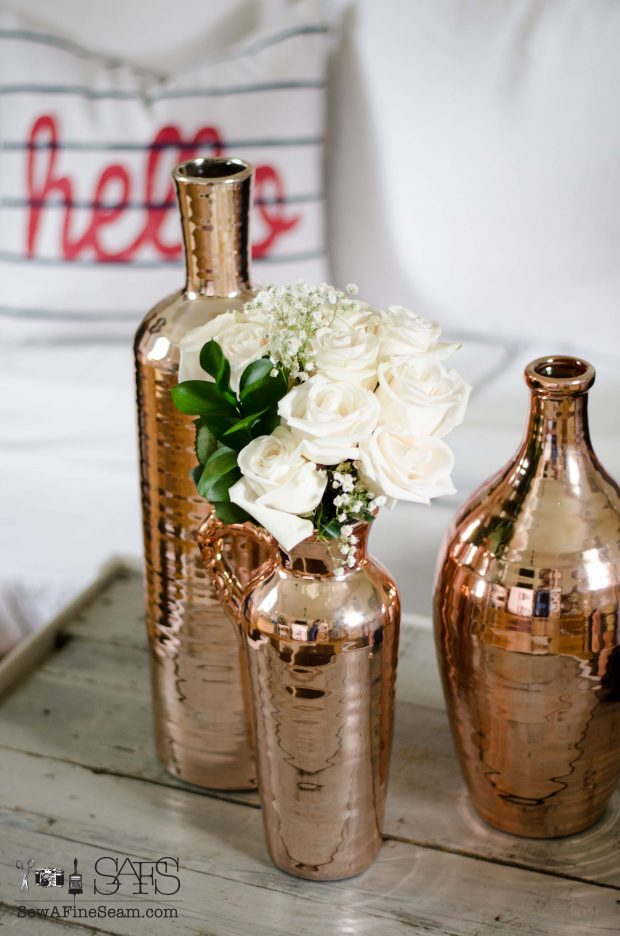 pillow hello with copper vases