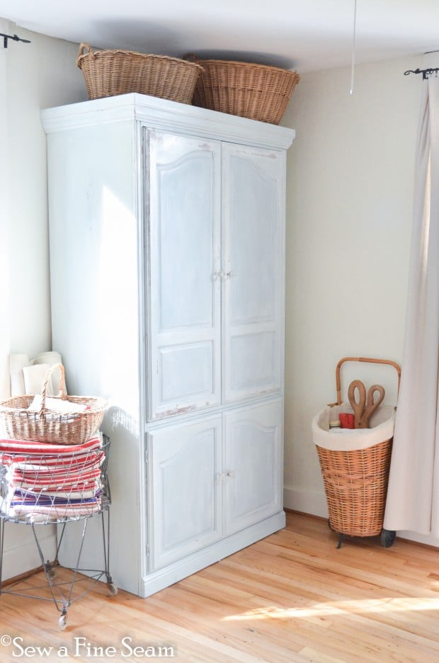 milk painted armoire creates much needed storage