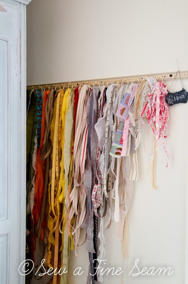 DIY ribbon organizer made from an old yardstick and hooks and key rings