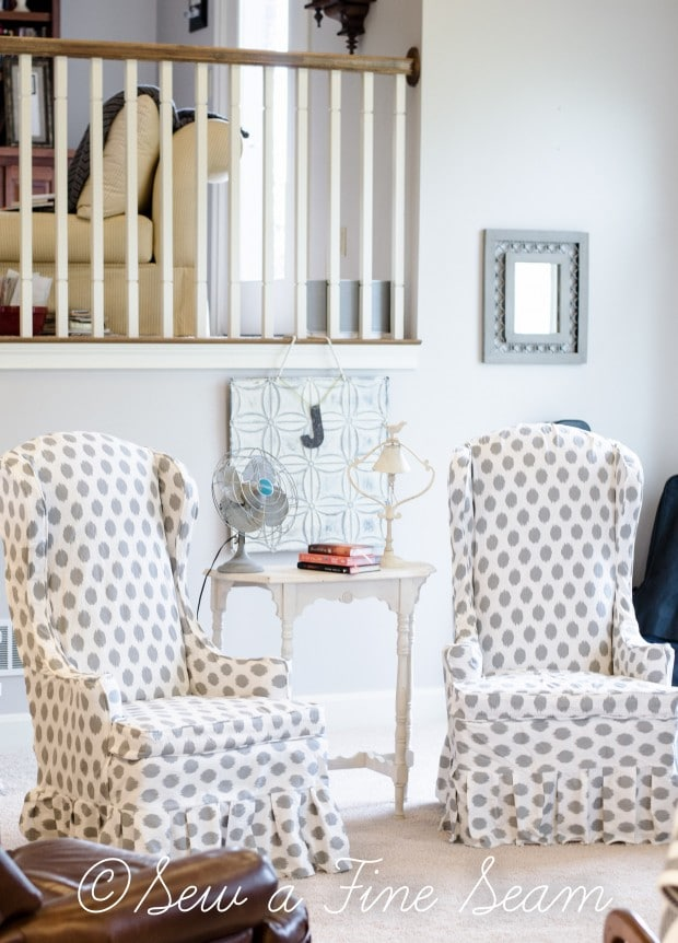 white and grey dot slipcovered chairs