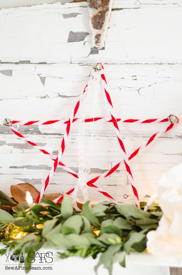 chenille stem star detailed with jingle bells and lace added to christmas decor