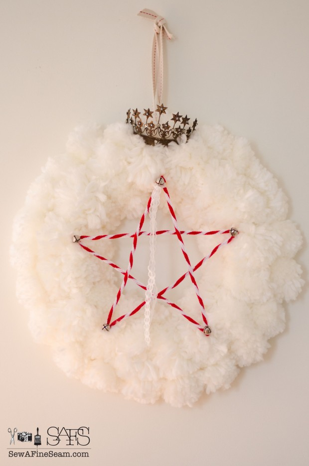 Chenille stem star tucked into a pom-pom wreath