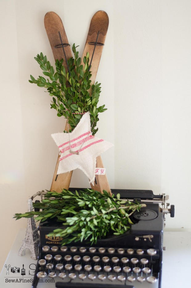 wood skis and a vintage typewriter decked out with boxwood and a handmade ornament