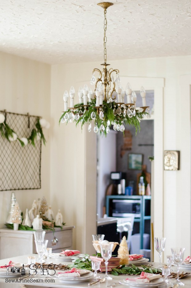 Dining Room chandelier decked out with cedar boughs