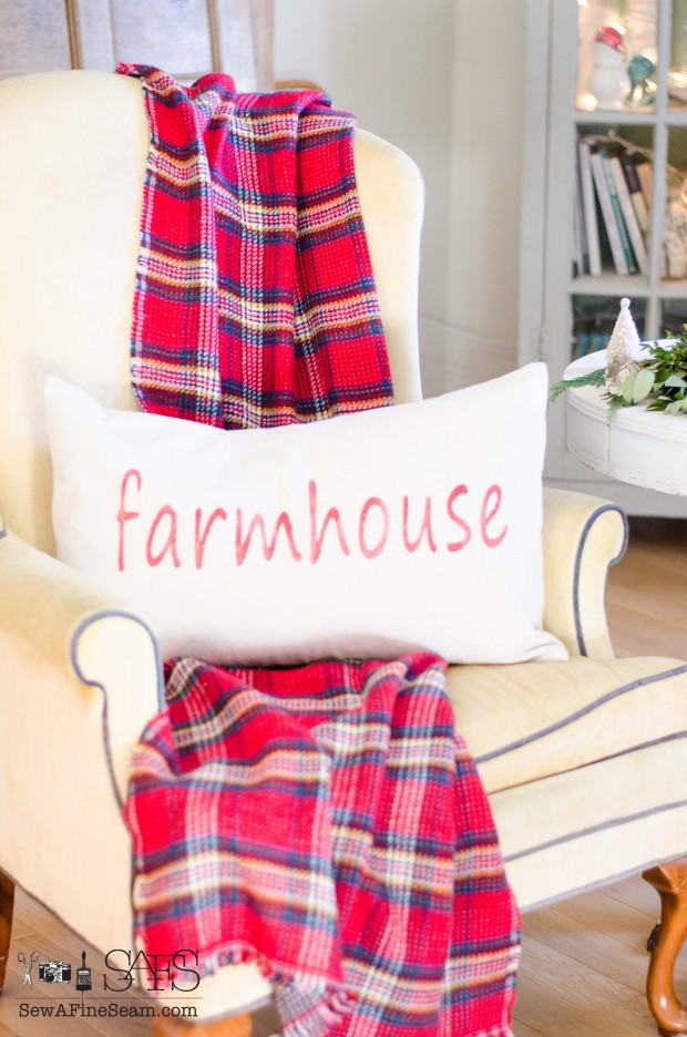 farmhouse pillow and plaid blanket scarf for christmas decor