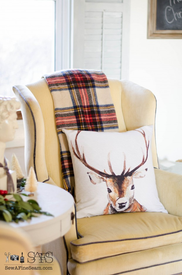 christmas decorated living room withdeer pillow from craftberry bush