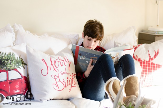 young teen reading a christmas book