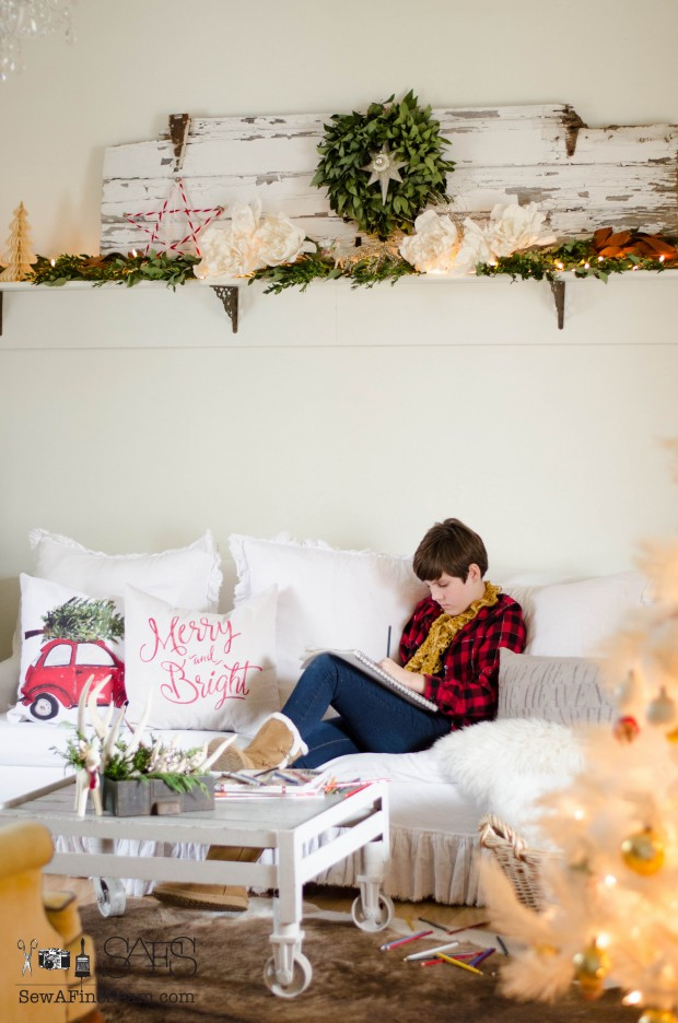 Artist teen drawing in a christmasy living room