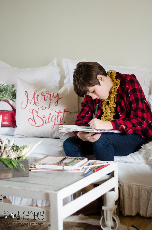 young teen drawing a christmas picture