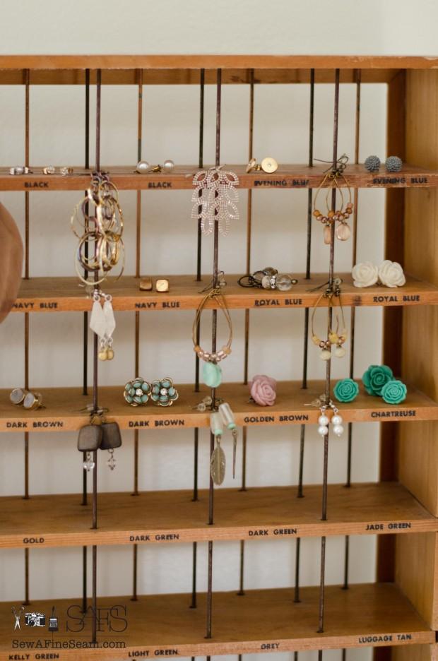 Earrings store wonderfully on this vintage RIT dye rack