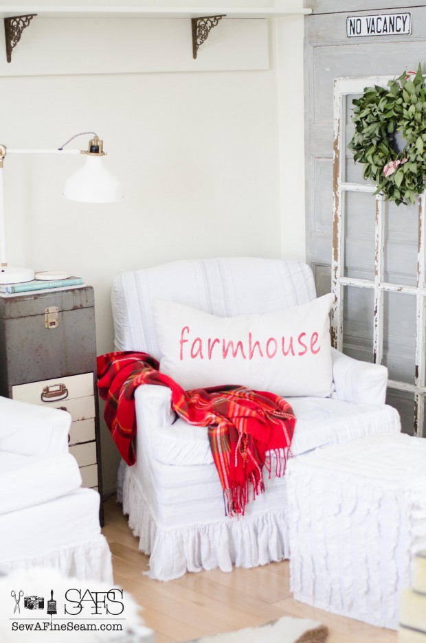 old window layered over an old door and a farmhouse pillow create a cozy nook