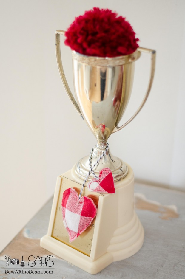 Trophy cup with a pompom and a toy tea bag