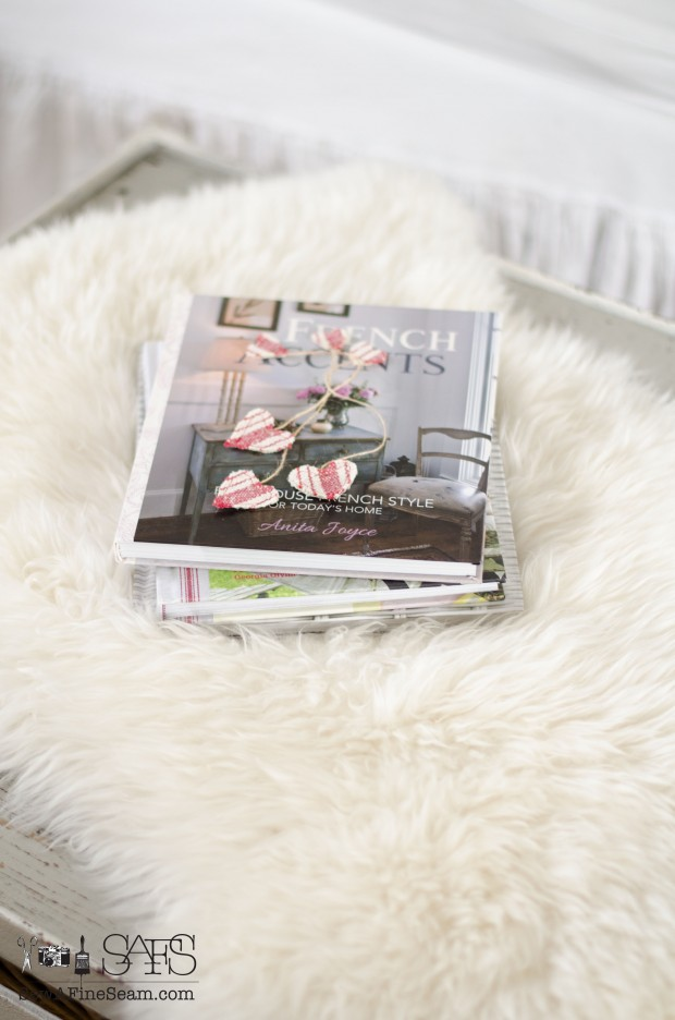 fur throw and a stack of books