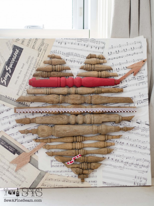 heart artwork made with old spindles, sheet music, and textiles