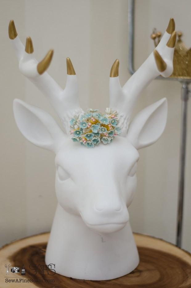 adding farmhouse charm with faux florals and a deer head