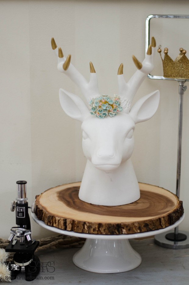 adding farmhouse charm with faux florals and a deer head for spring