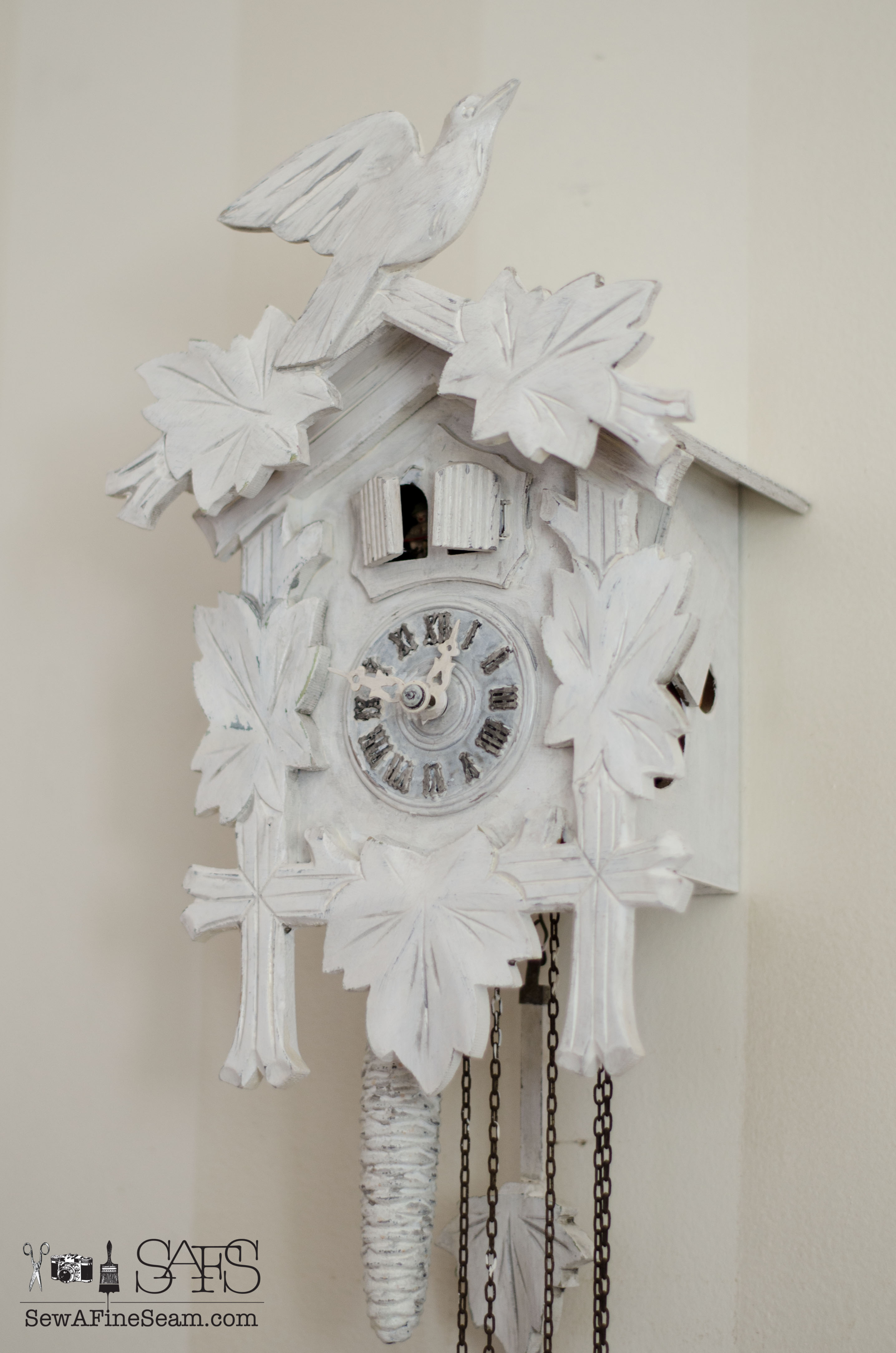 Cuckoo clock makeover sew a fine seam cuckoo clock painted white and hung on a white striped wall amipublicfo Image collections
