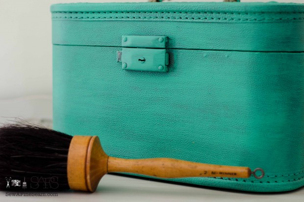 Upcycled with paint an old suitcase gets new life