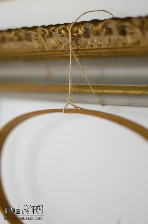 Flower Vases from Tiny Bottles and an embroidery hoop and hung from a vintage frame