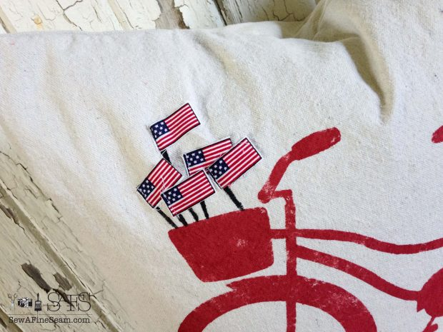 patriotic pillow flags in bike baskt