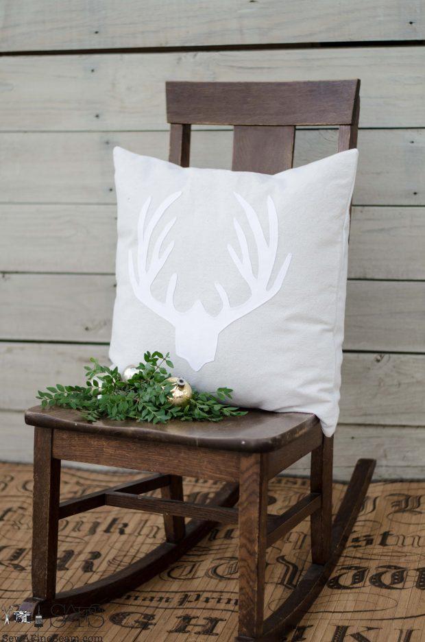 white-deer-rack-on-neutral-christmas-pillows-2016
